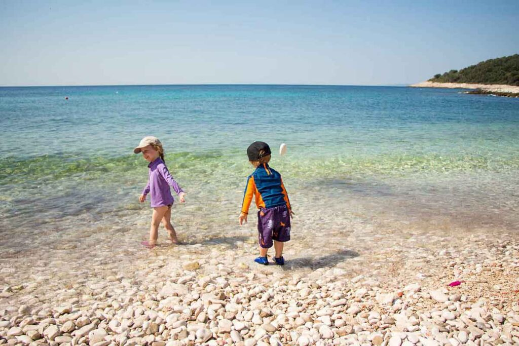 Kids playing on Milna Beach Hvar Island Croatia - Best Beaches Hvar with Kids