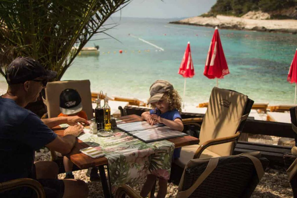 eating on beach on Hvar with kids