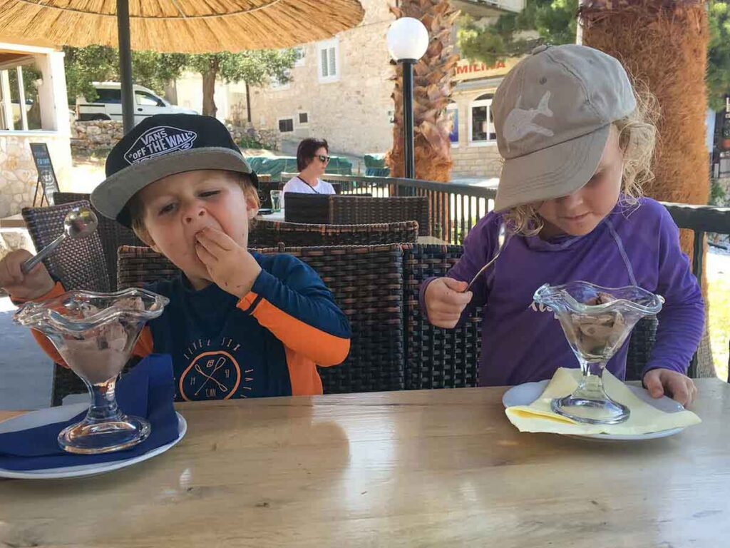 Having ice cream near Milna Beach Hvar, Croatia with Kids