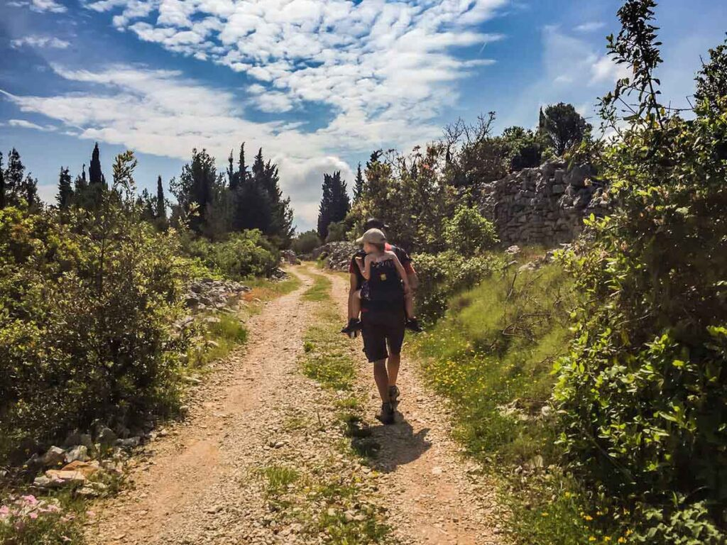 Hiking on a country road on Korcula Island Croatia with Kids