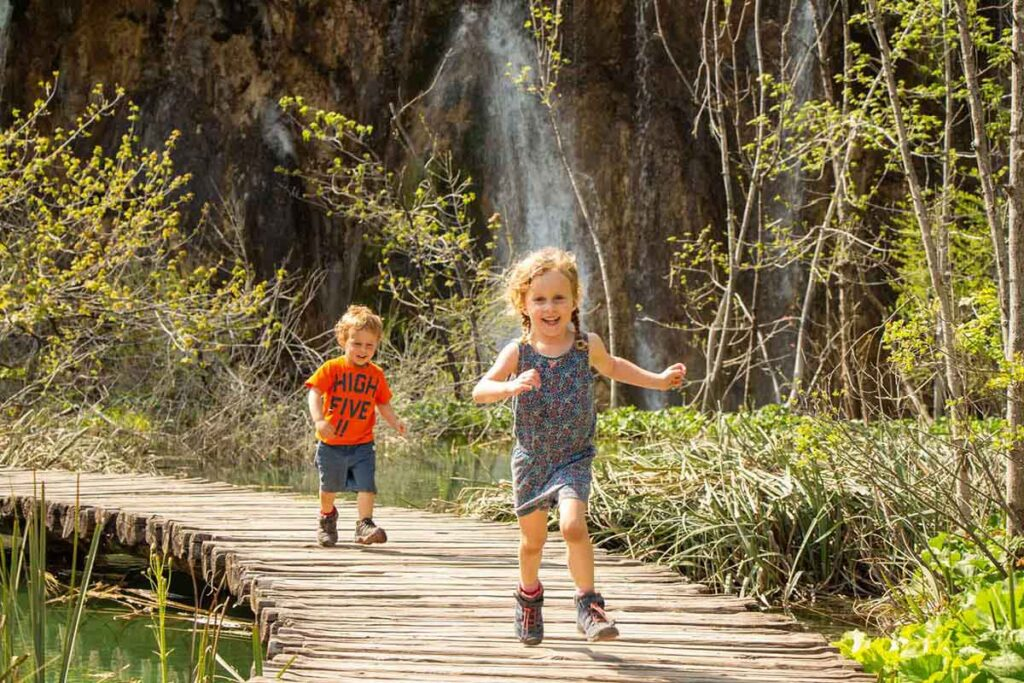 Plitvice Lakes with Kids running on wooden boardwalk