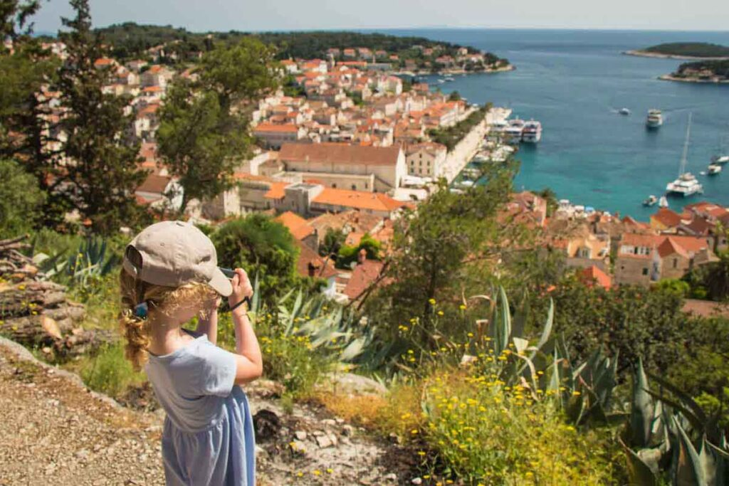 Taking pictures of view on the way to the Fortress on Hvar with Kids