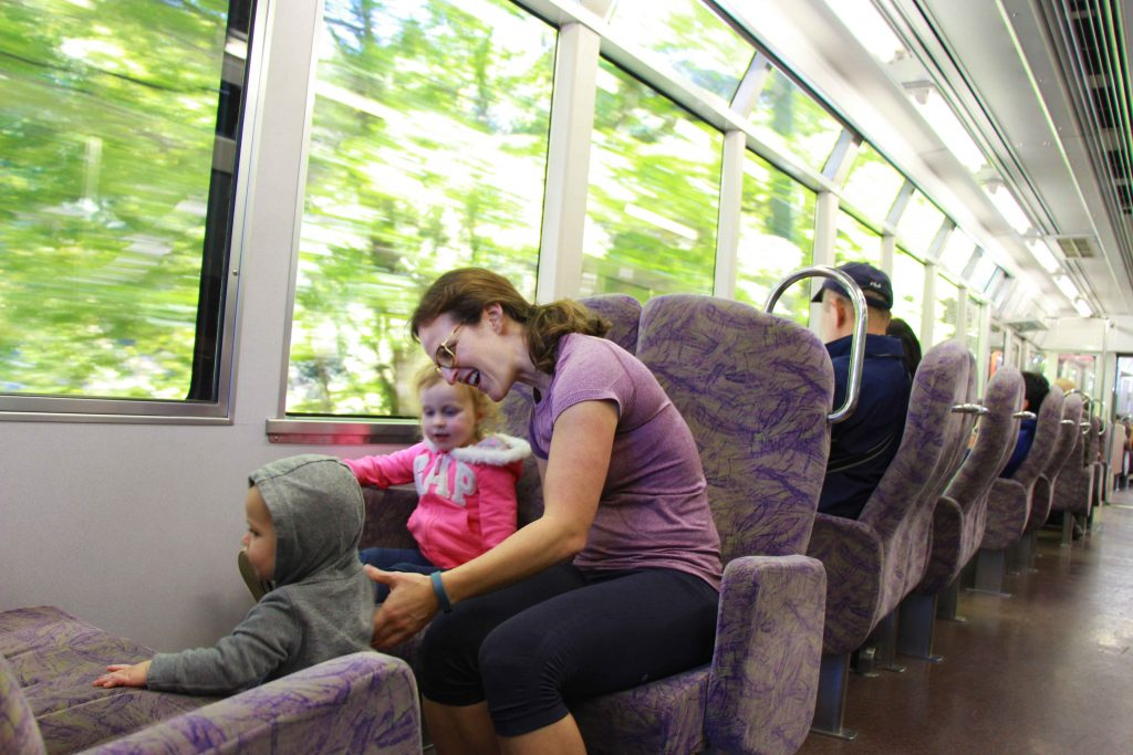 a family enjoys the scenic train ride to Kurama, Japan