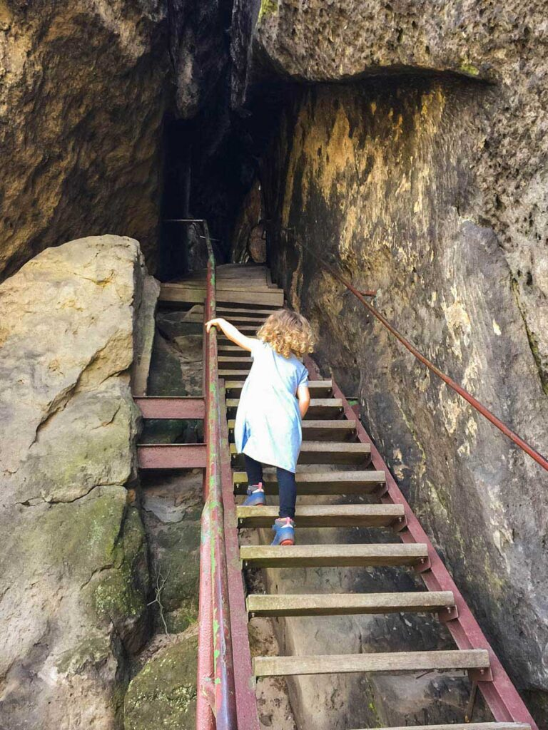 climbing stairs to lookout on Bohemian Switzerland hike