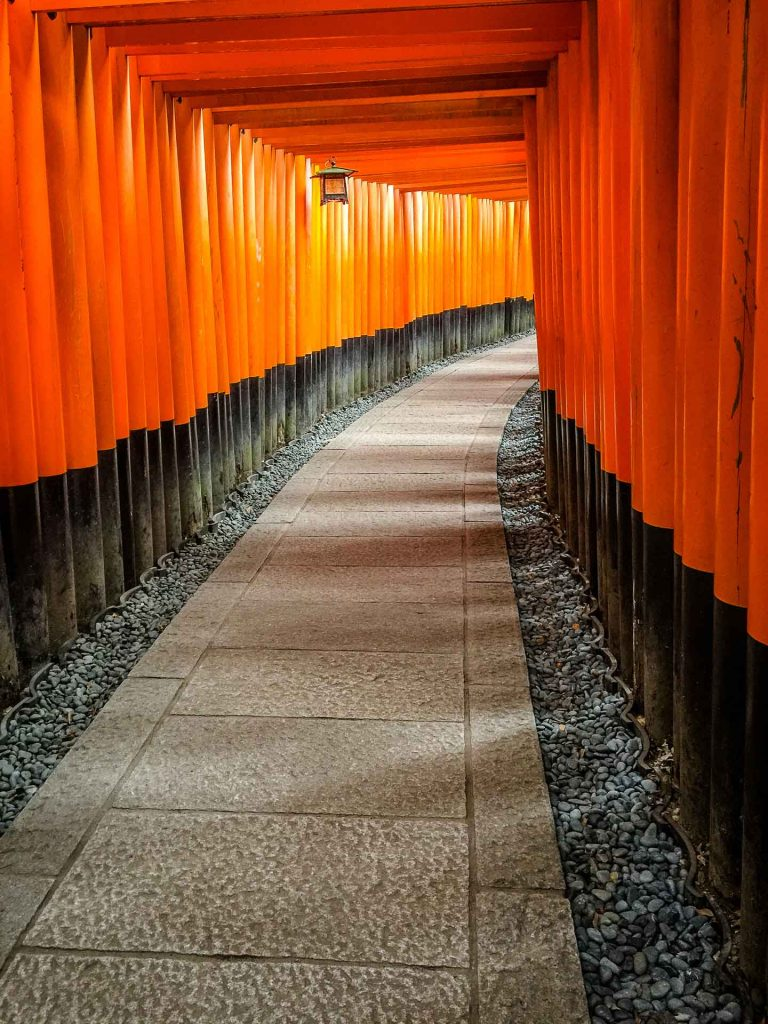 The famous orange and black torii gates at Fushimi Inari Shrine in Kyoto, Japan