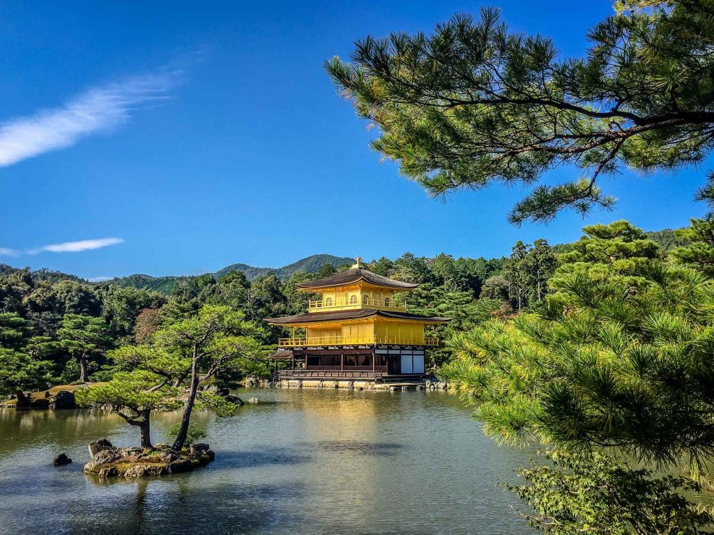 The Kyoto Golden Temple shines in the bright sun
