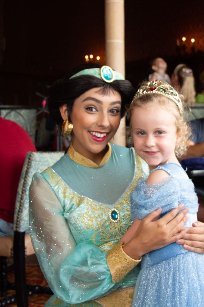 a 5 year old girl meeting princess jasmine - walt disney world - Cinderella's Royal Table - the best Disney princess experience