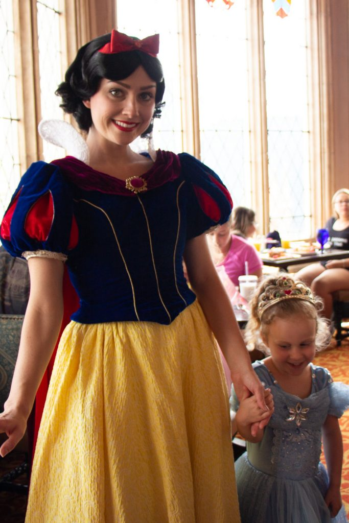 meeting snow white disney world at Cinderella's Royal Table - easily one of the best Disney princess experiences at Disney World