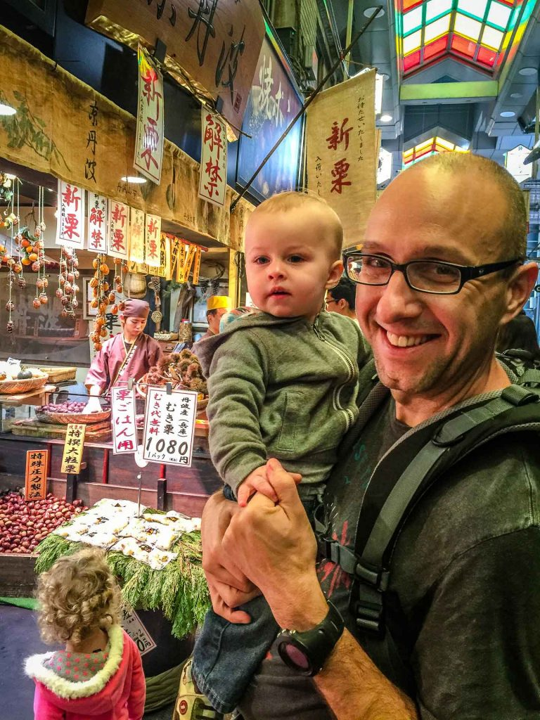 Family enjoying the Nishiki Market on a rainy day in Kyoto Japan
