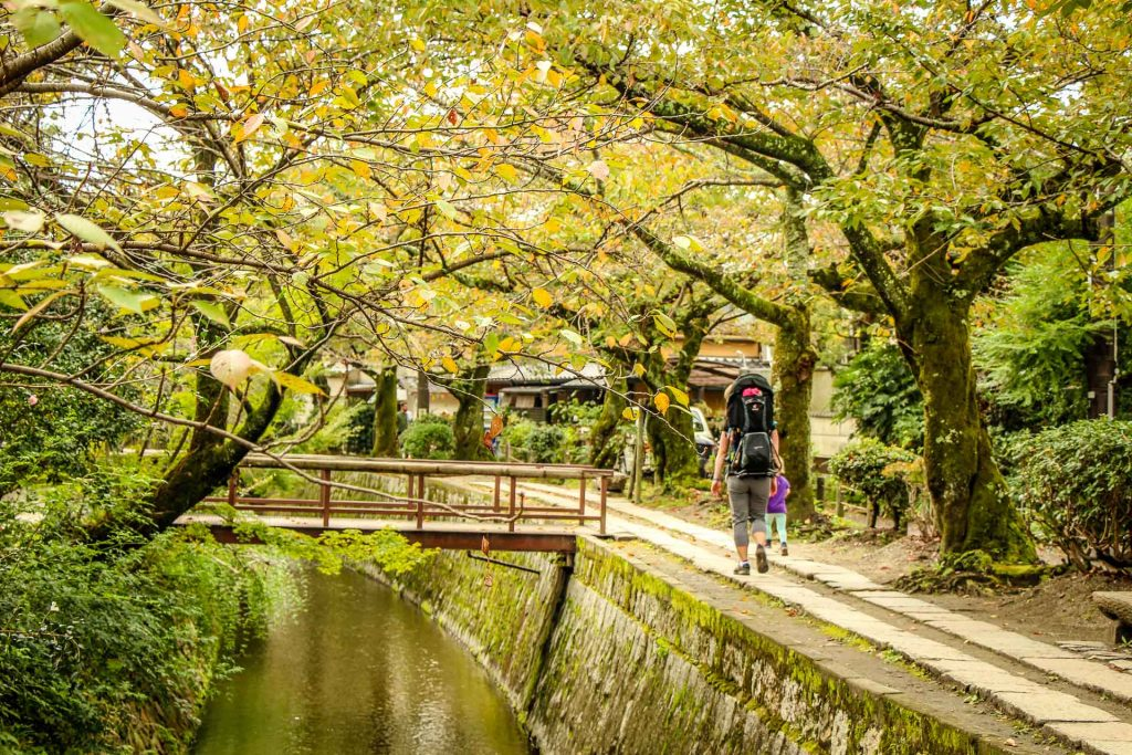 enjoying a family walk along the beautiful canal next to the Philosophers Path Kyoto Japan