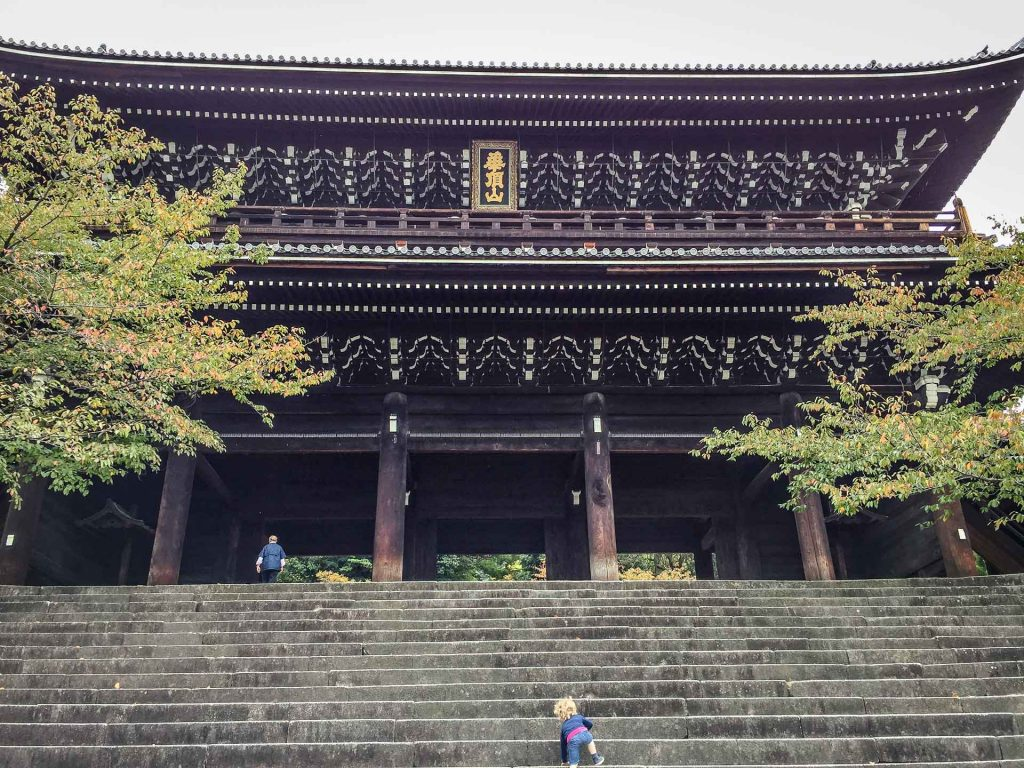 A toddler climbs the steps of the Chion Temple in Kyoto