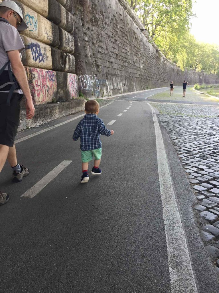 When traveling to Rome with kids, you'll need to find a place to let them blow off steam. Try a walk along the Tiber River Pathways