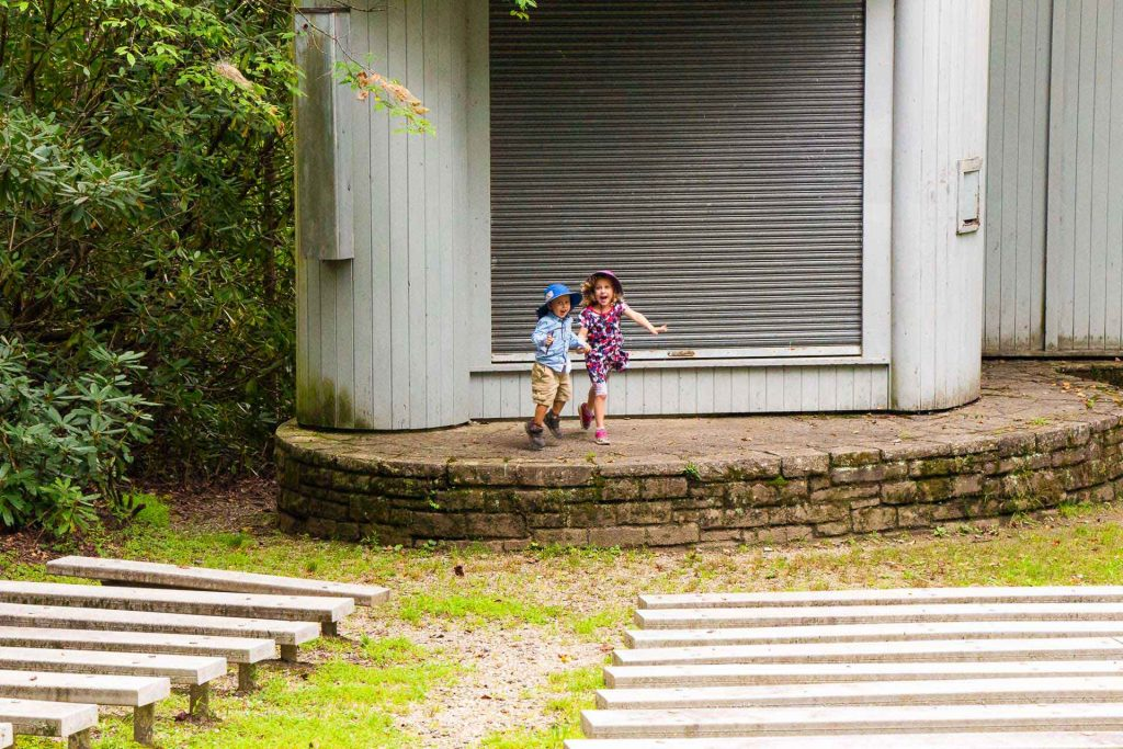 kids always find fun things to do while hiking - a show on the amphitheatre at Price Lake on the blue ridge parkway