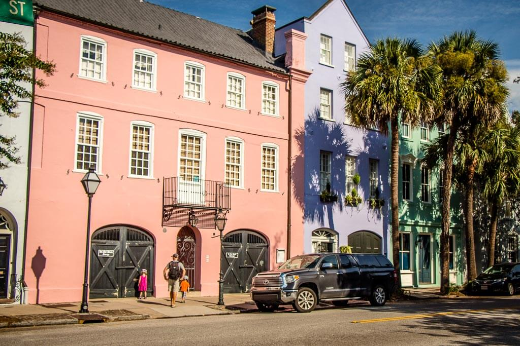 walking by Rainbow Row in Charleston with Kids