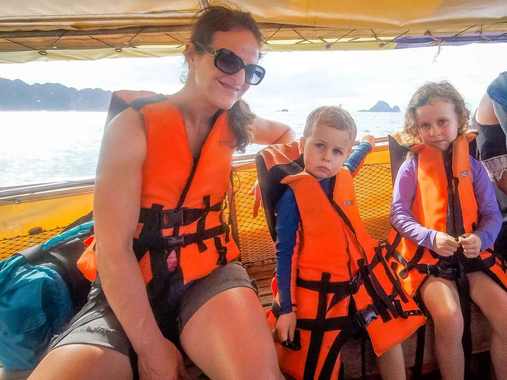Taking long tail boat with kids in Thailand