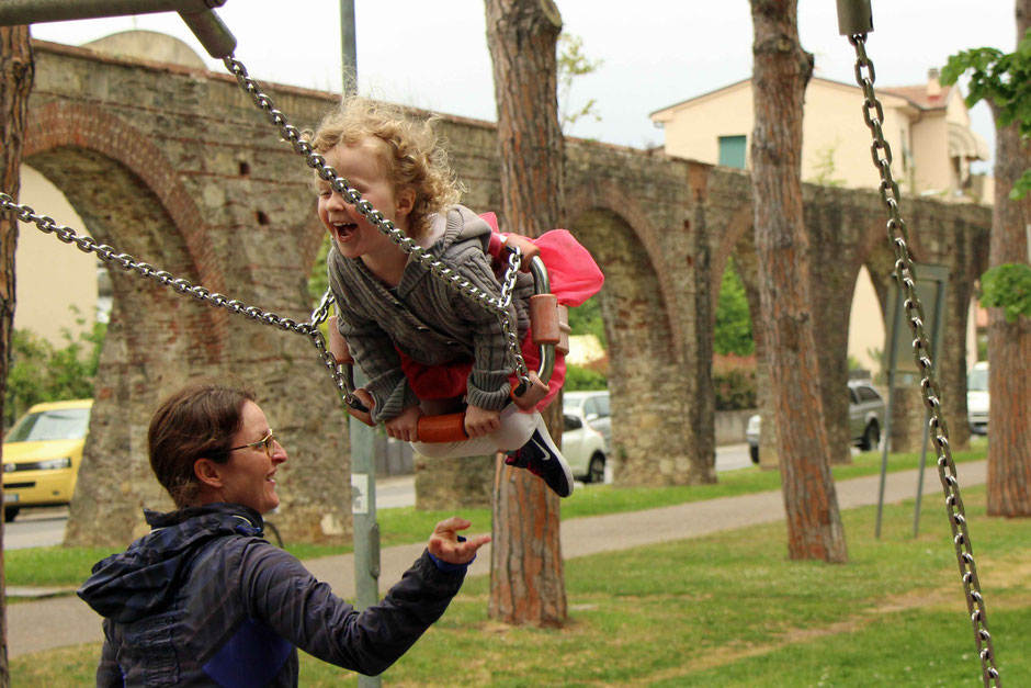 A Pisa playground next to the Pisa Aqueduct is a great thing to do in Pisa for the whole family