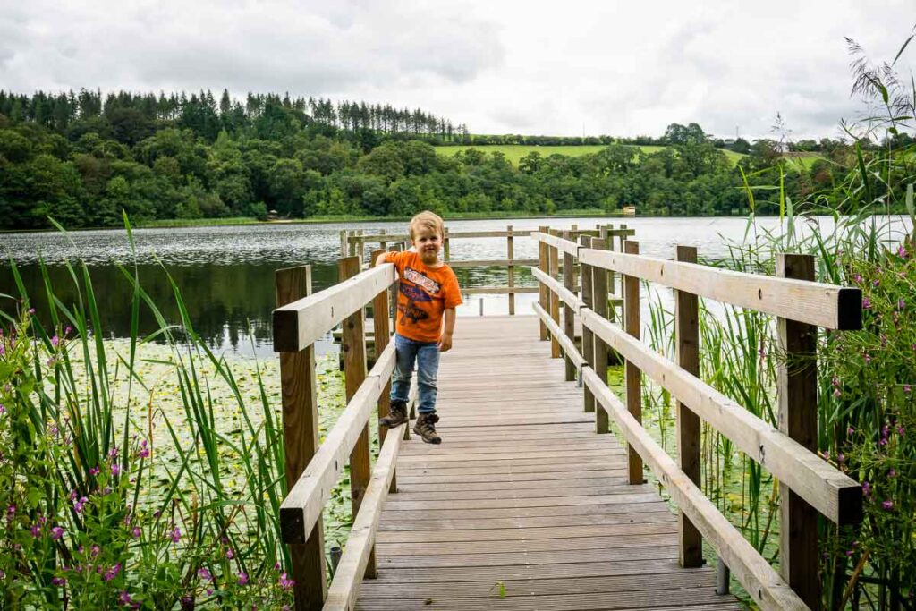 image of boy on dock with lake in the background at Blarney Castle and Gardens