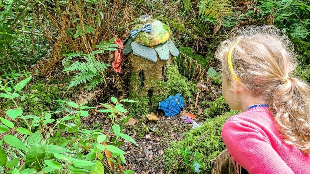 girl looking at fairy house at Blarney Castle Gardens in Cork with Kids