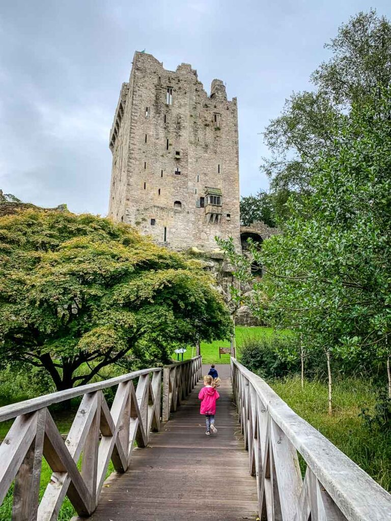 image of children running across bridge towards Blarney Castle
