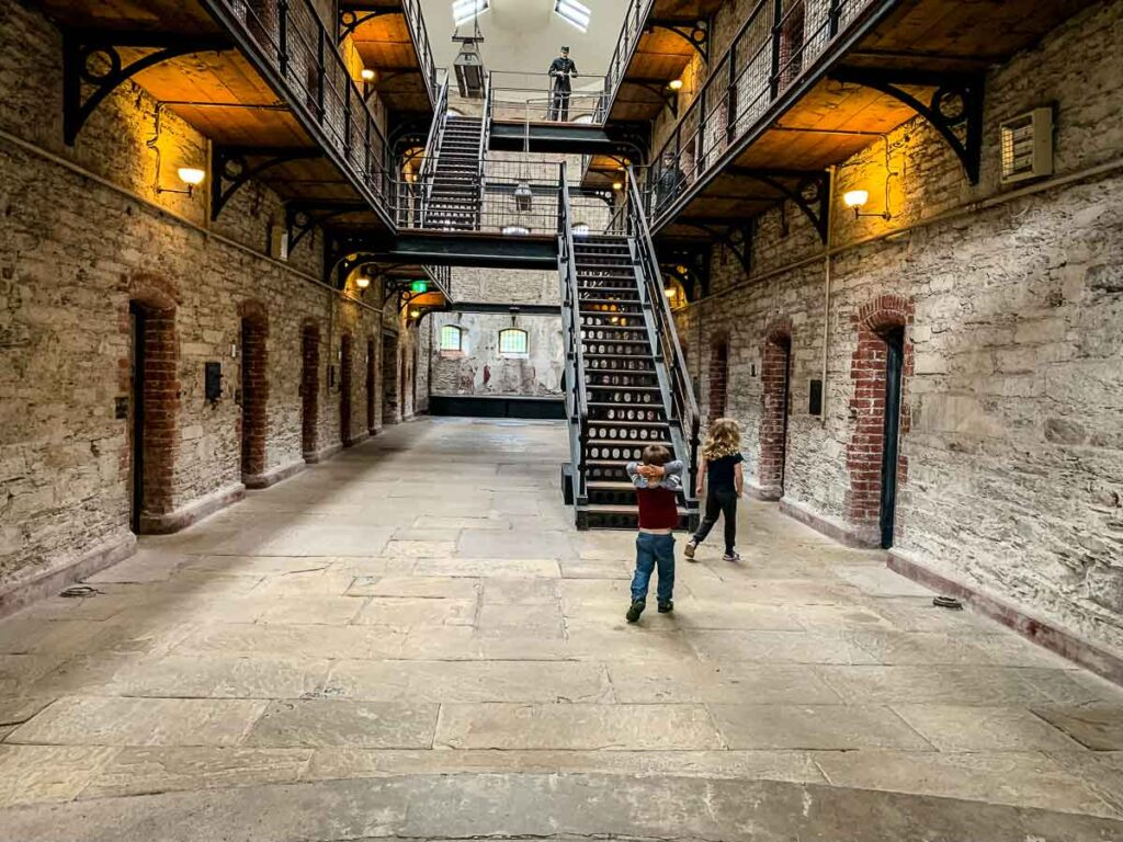 image of two kids walking in Cork City Gaol
