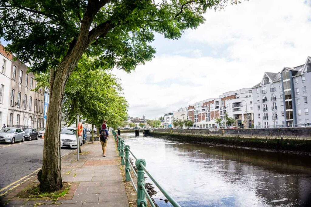 image of father with boy on shoulders walking in Cork