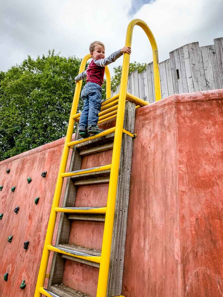 image of boy climbing ladder at playground in Cork