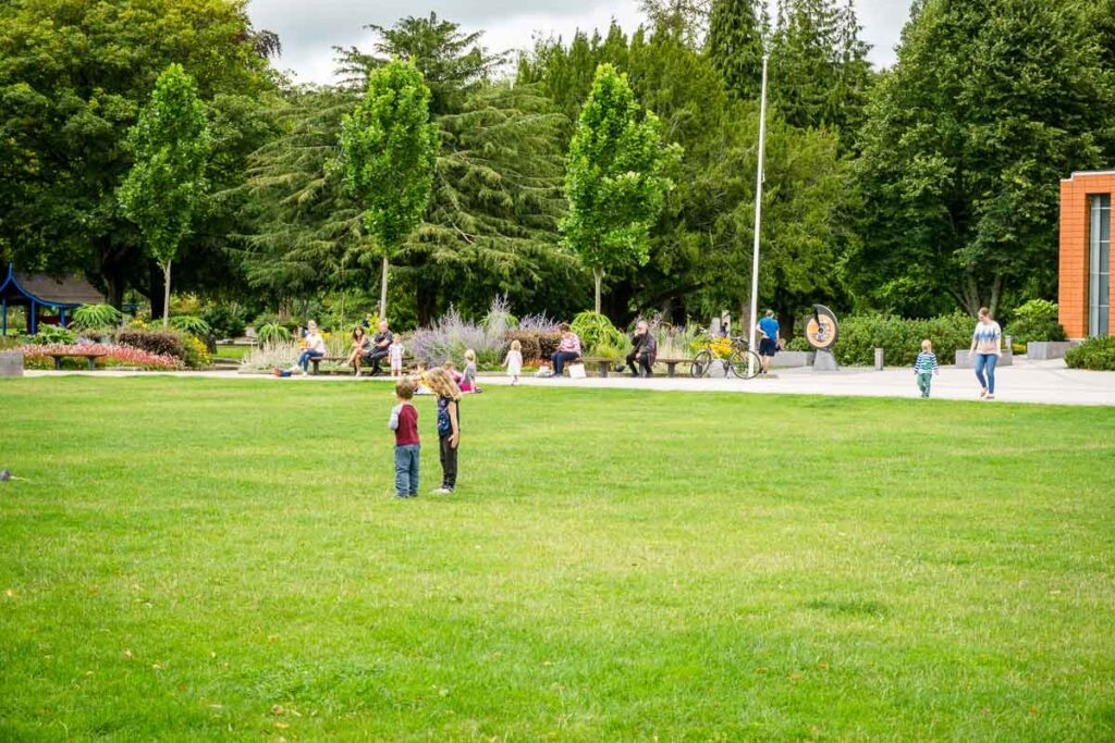 image of two kids playing on grass at Fitzgerald Park in Cork Ireland