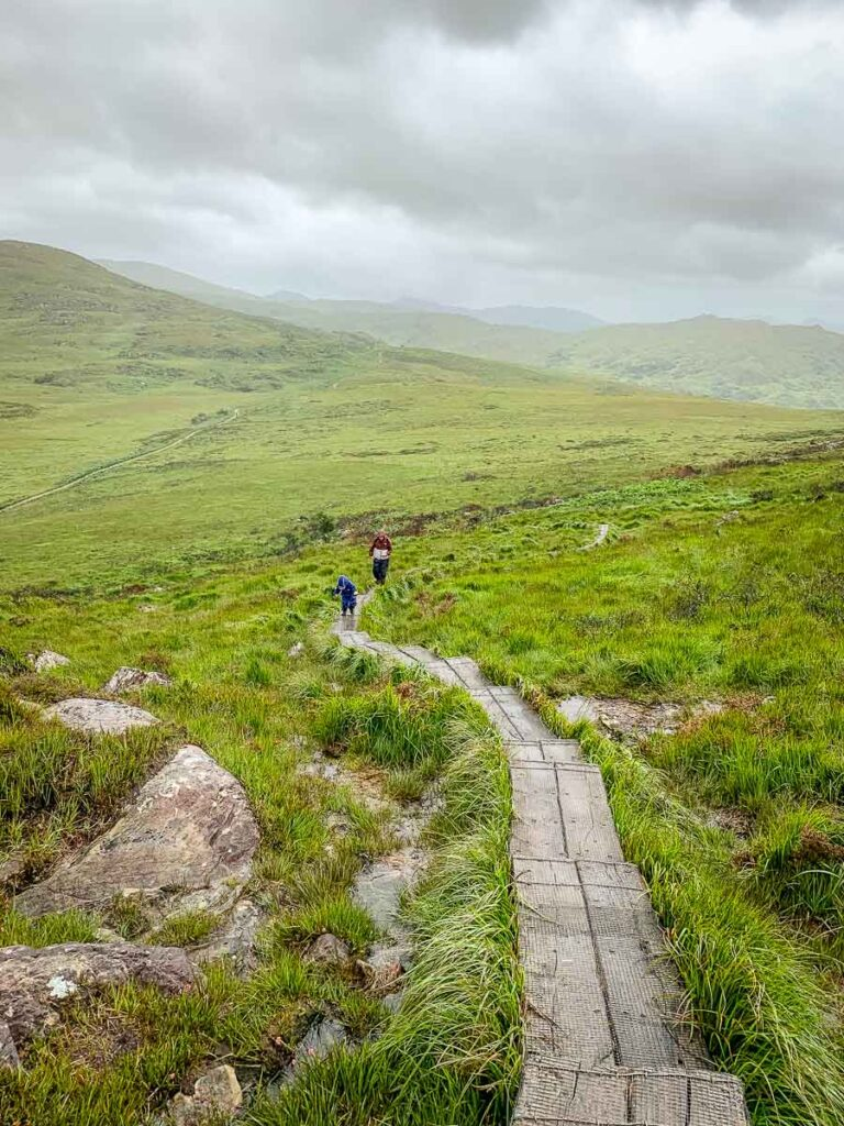 image of family hiking Torc Mountain