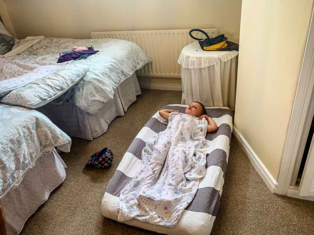 image of boy on inflatable toddler bed in hotel room