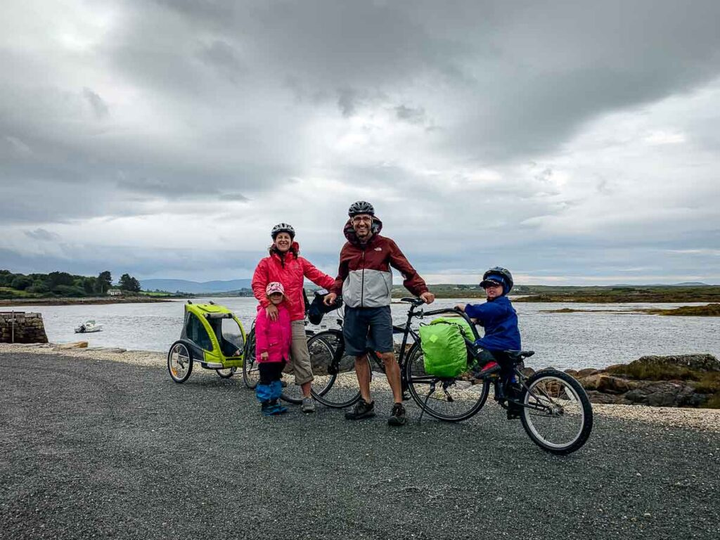 image of family cycling and posing in front of ocean