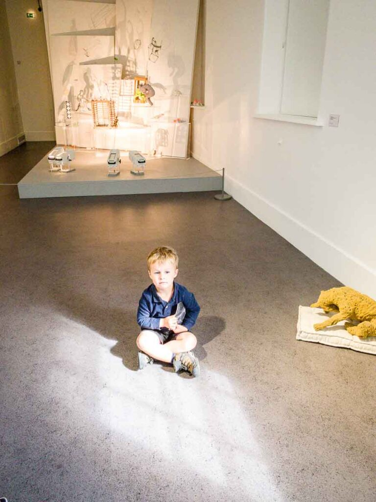 image of boy sitting on floor in Irish Museum of Modern Art in Dublin