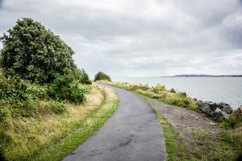 image of pathway to Poolbeg Lighthouse in Dublin Irelandwith ocean on the right