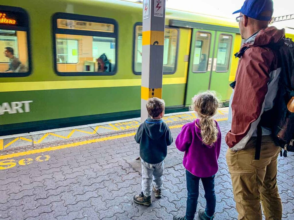 image of children on train platform looking at train