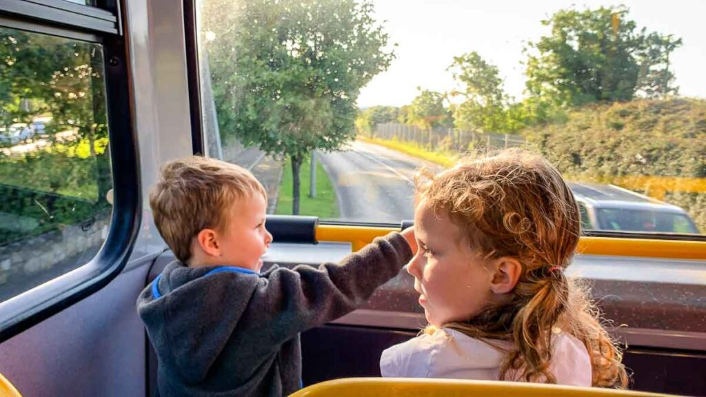 image of kids on a bus