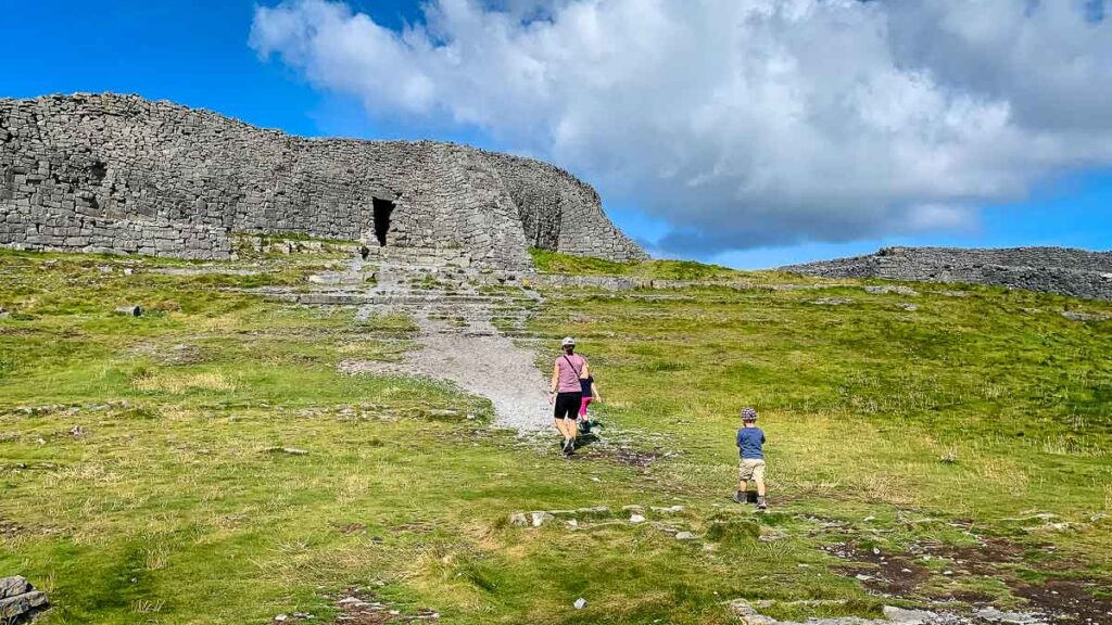 image of woman and two children visiting ruined fort on Inishmore Aran Islands Ireland