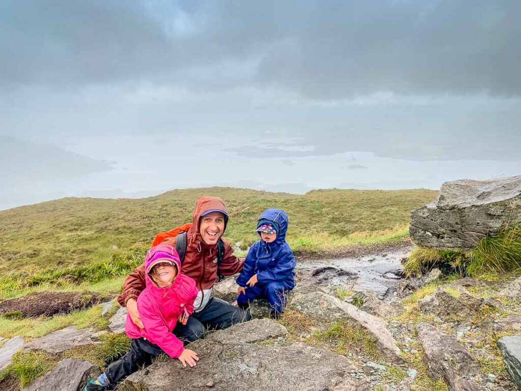 image of family at the summit of Torc Mountain in Killarney National Park in Ireland