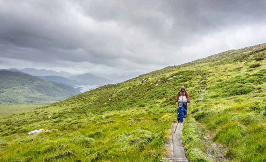 image of hikers on Torc Mountain hike in Killarney National Park Ireland