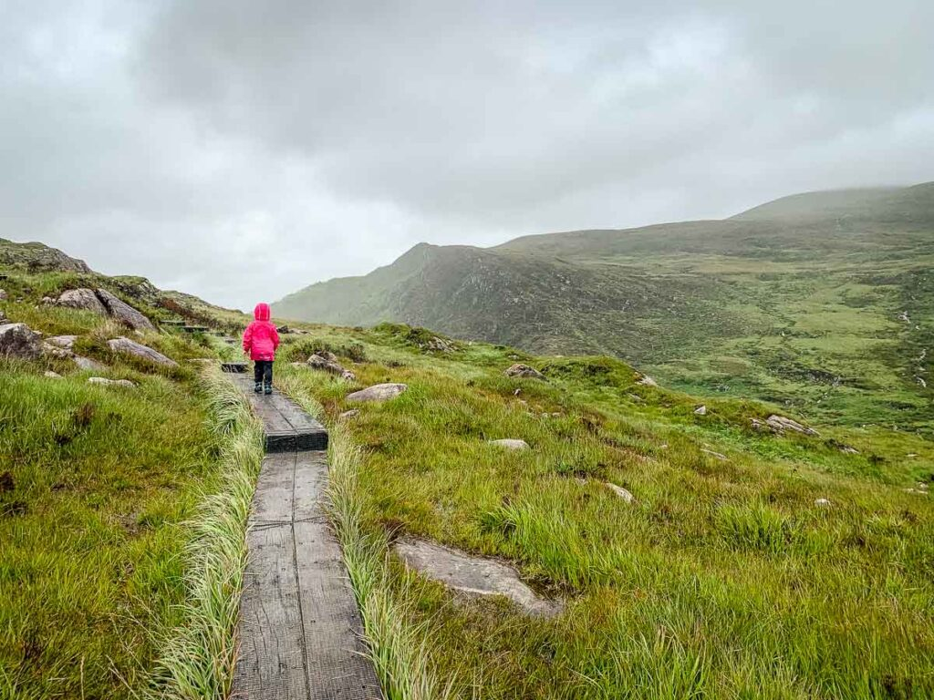 image of girl hiking on the boardwalks on Torc Mountain in Killarney National Park