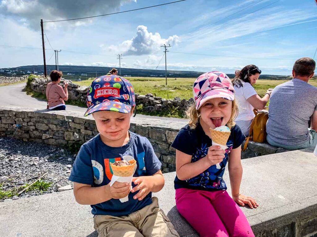 image of two children eating ice cream cones