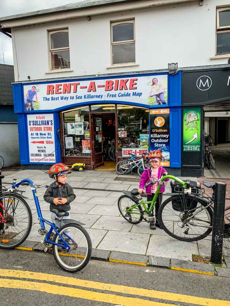 image of two kids in front of bike rental