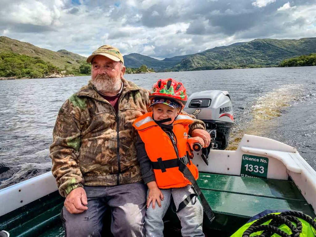 image of man and boy on a boat on Lakes of Killarney in Ireland