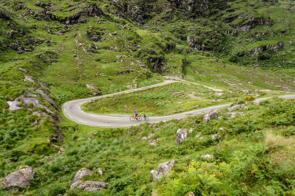 image of cyclist and road on the Gap of Dunloe mountain pass in Killarney National Park