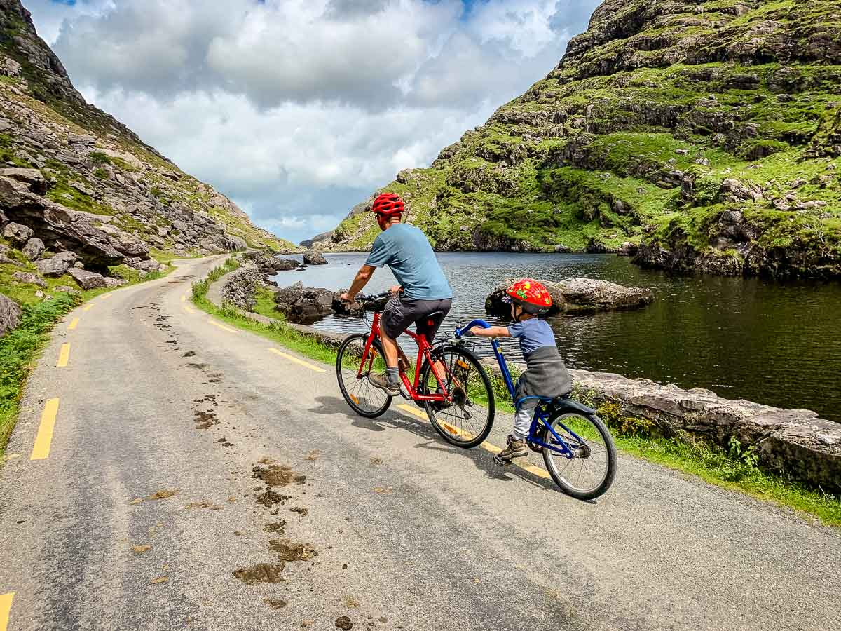 image of cycling past water on Gap of Dunloe in Killarney