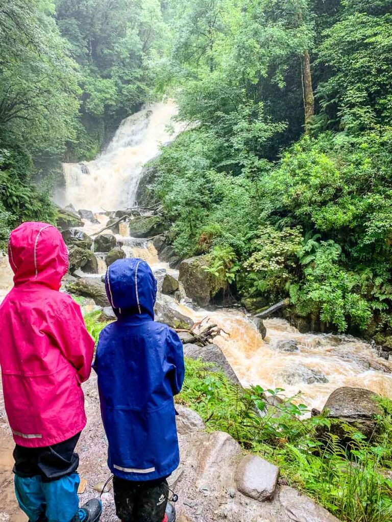 image of two kids looking at Torc Waterfall in Killarney National Park Ireland
