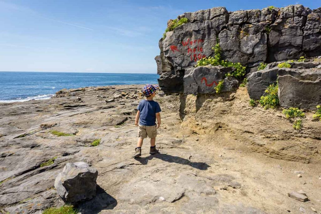 image of boy walking to wormhole aran islands