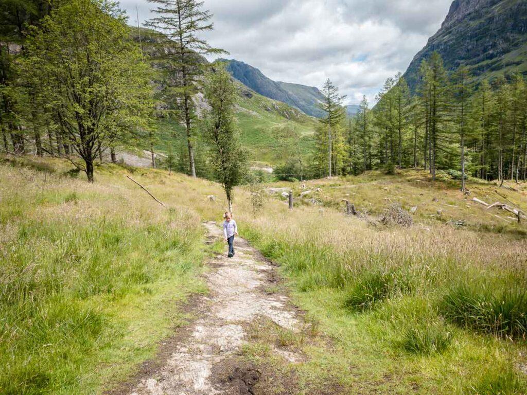 image of girl hiking An Torr hike in Glencoe Scotland