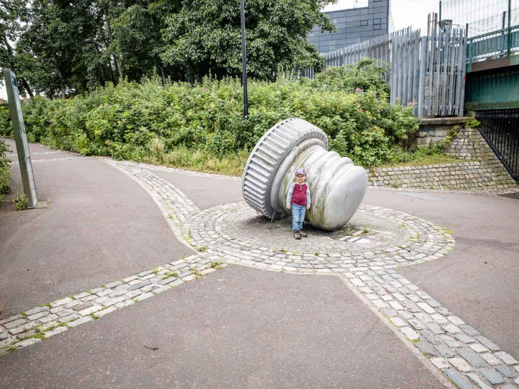 Image of boy next to sculpture along Lagan Towpath in Belfast
