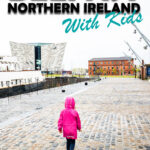 Image of girl walking towards Titanic Belfast with text overlay of Belfast Northern Ireland with Kids