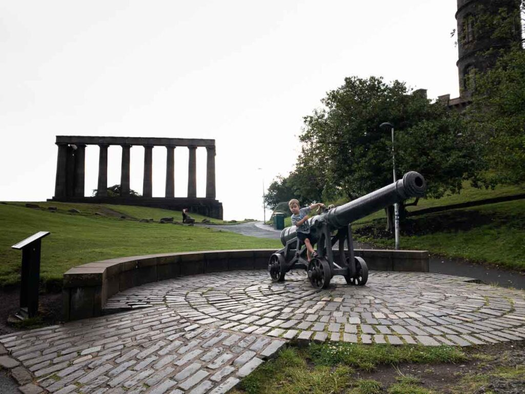 image of cannon in front of National Monument of Scotland on Calton Hill in Edinburgh
