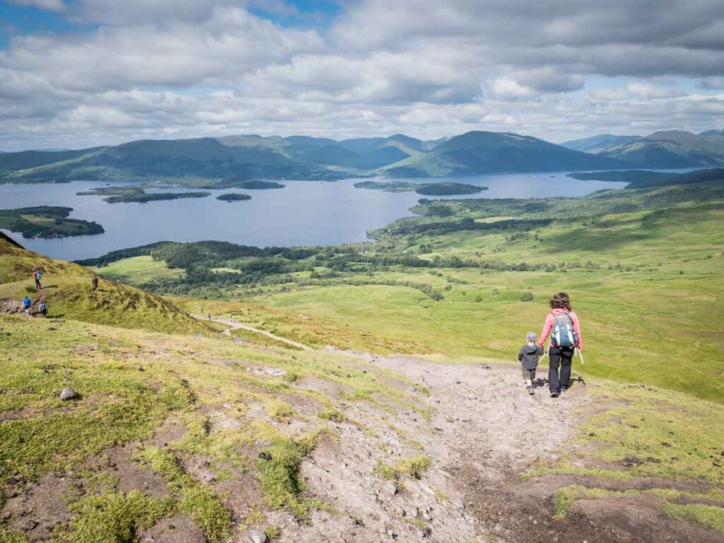 image of mother and boy walking down the hill towards Loch Lomond on the Conic Hill walk